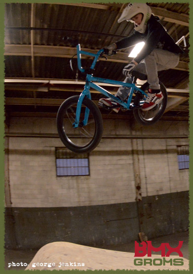 "Lukas Halahan tweaks a t-bog on the Sunday Primer 18"" BMX in the Woods jump line at the wheelmill."