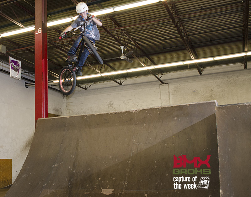 Tyler moto whips the spine at Inflow skatepark in Canada.