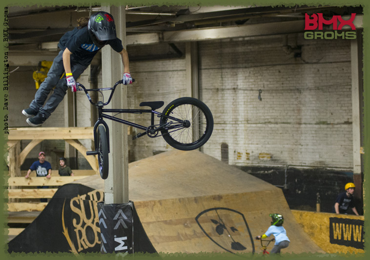 12 year old BMX Rider Brady Baker chucks a tailwhip in the Wood Jump Room.