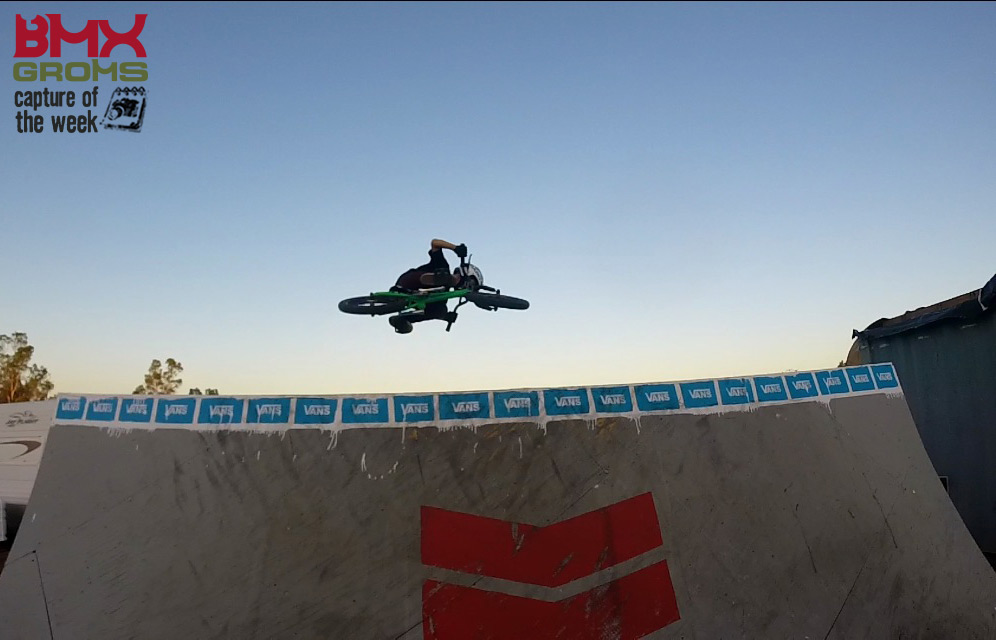 Ryder Lawrence airing a spine on his 16 inch BMX Bike and taking picture of the week on BMX Groms