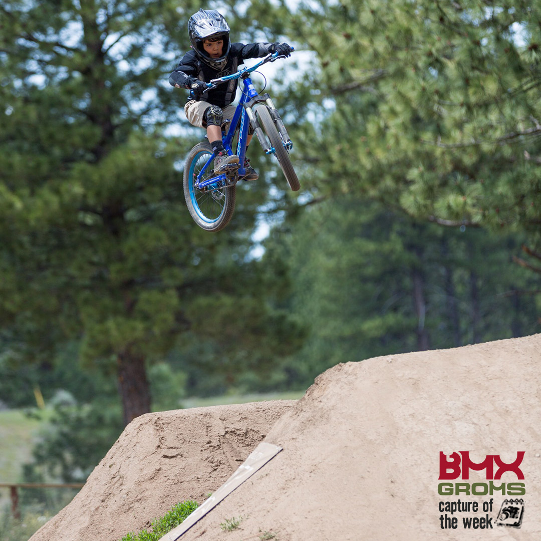 Soren Zengerle hitting a large trails line on his MTB and taking BMX Groms Picture of the Week