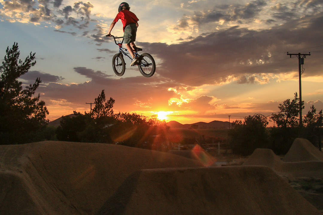 Ryder Lawrence getting some air time as the sun goes down at Woodward West Trails.